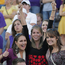 25 October 2008:  A Georgia fan (center) with two LSU fans during the Georgia Bulldogs 52-38 victory over the LSU Tigers at Tiger Stadium in Baton Rouge, LA.