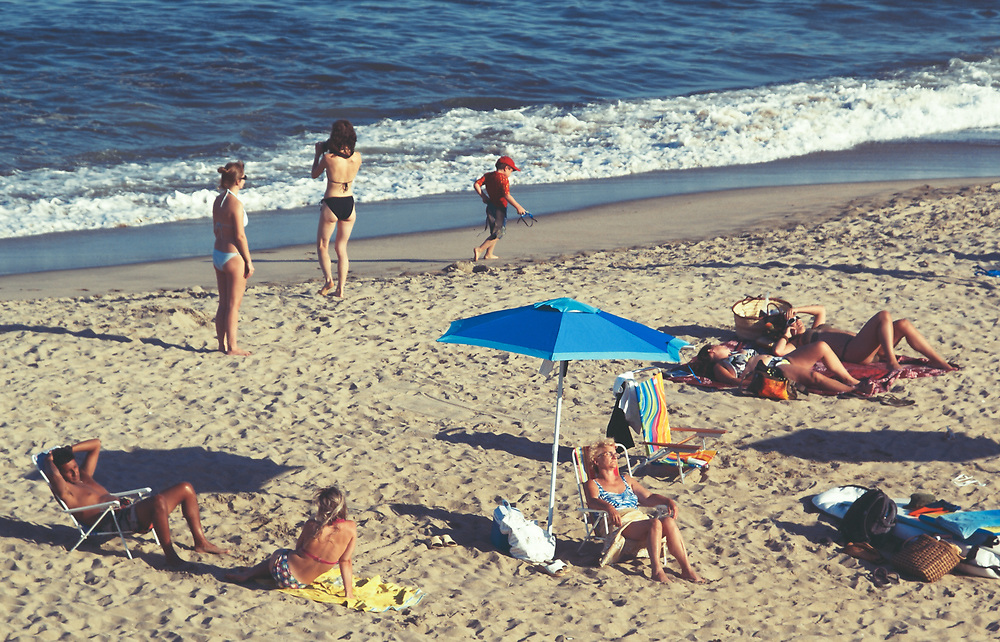People enjoying summer at the beach. Long Branch, NJ