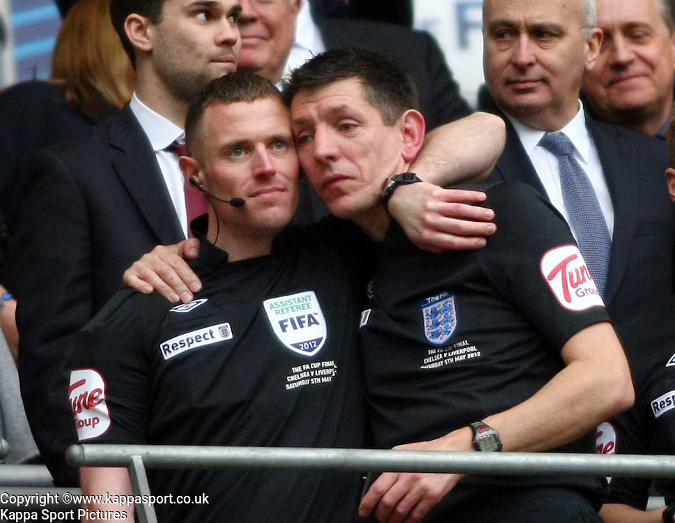 FA Cup Final - Chelsea v Liverpool  05.05.12<br /> Assistant referee Stuart Burt  shows a tear with fellow assistant after recieving their FA Cup Medals, 5th May 2012 FA Cup Final
