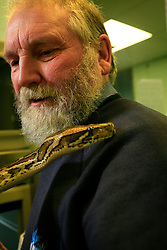 UK ENGLAND LONDON 3MAR09 - Bob Wingate, deputy manager of the Heathrow Animal Reception Centre holds a Burmese Python.  The Heathrow Animal Reception Centre - formerly known as the Animal Quarantine Station - is part of the Veterinary Sector of the City of London Environmental Services Directorate and has over the past 25 years established itself as a world leader in the care of animals during transport...jre/Photo by Jiri Rezac..© Jiri Rezac 2009