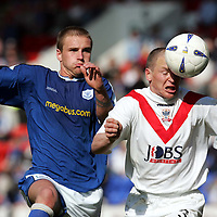 St Johnstone v Airdrie United..23.04.05<br />Paul Lovering gets to the ball ahead of Ryan Stevenson<br /><br />Picture by Graeme Hart.<br />Copyright Perthshire Picture Agency<br />Tel: 01738 623350  Mobile: 07990 594431