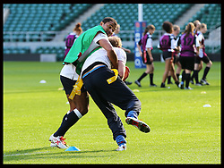 Prince Harry is tackled by Jason Robinson as they take  part in a Rugby Football Union schools coaching session at Twickenham Stadium in London, Thursday, 17th October 2013. Picture by Stephen Lock / i-Images