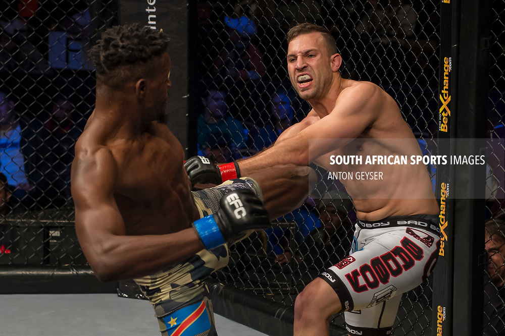 JOHANNESBURG, SOUTH AFRICA - MAY 13: Alain Ilunga kicks Barend Nienaber during EFC 59 Fight Night at Carnival City on May 13, 2017 in Johannesburg, South Africa. (Photo by Anton Geyser/EFC Worldwide/Gallo Images)