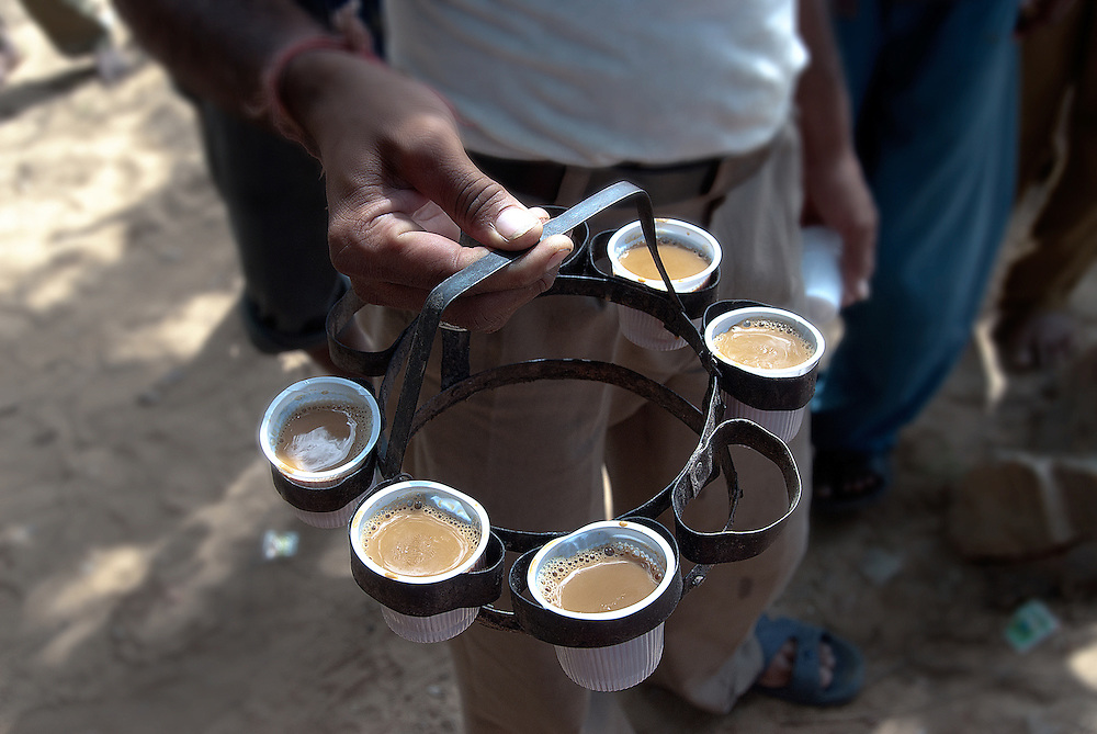 """For many English speakers outside those regions, the term """"chai"""" is synonymous with masala chai, as further described below. The pleonasm chai tea is sometimes used to indicate spiced milk tea as distinct from other types of tea. Numerous coffee houses use the term chai latte for their version to indicate that the steamed milk of a normal caffè latte is being flavored with a spiced tea concentrate instead of with espresso, without necessarily implying the addition of coffee (though also see the Western """"chai"""" modifications at the end of the article). Some coffeehouses and brand names refer to their product as chai tea latte. [souce: Wikipedia]"""