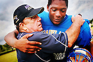 Daytona Beach Mainland head football coach John Maronto gets a hug from Erick (sp?) Scott at the end of practice, Daytona Beach, Thursday, August 14, 2008. Maronto underwent heart surgery last winter and has returned to lead the nationally ranked Buccaneers. (Roberto Gonzalez/Orlando Sentinel)