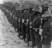 Some of our brave collared boys who helped to free Cuba'  Formation of Black soldiers, after Spanish-American War. stereograph. c1899.