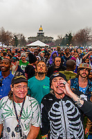 Crowd smoking pot at 4:20 PM, 420 Cannabis Culture Music Festival, Civic Center Park, Downtown Denver, Colorado USA.