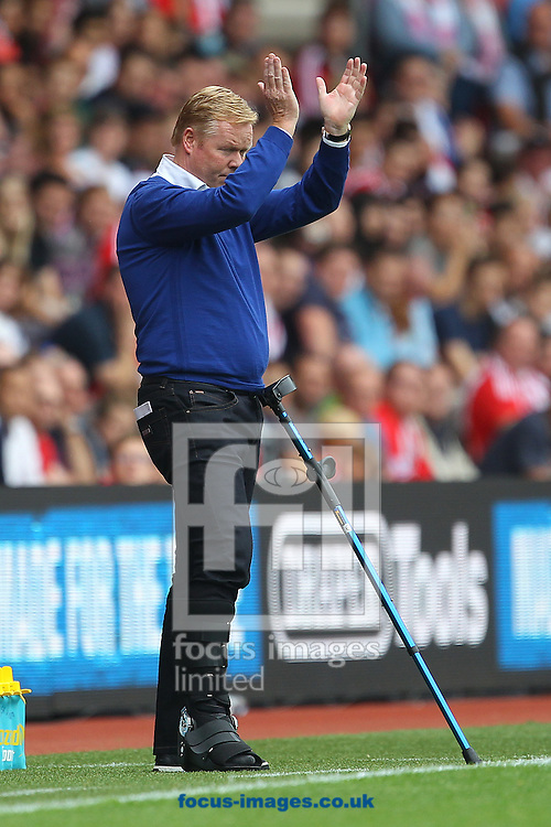 Southampton Manager Ronald Koeman acknowledges the home fans during the Barclays Premier League match at the St Mary's Stadium, Southampton<br /> Picture by Paul Chesterton/Focus Images Ltd +44 7904 640267<br /> 30/08/2015