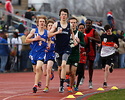 Competitors round a corner in the boys 1,600-meter run at the His and Her track and field invitational at Penfield High School on Saturday, April 26, 2014.