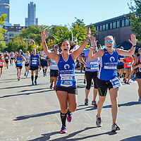 Runners from the Lurie Childrens Hospital Chicago Marathon Team celebrate during the Chicago Marathon.