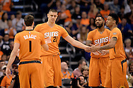 Nov 7, 2014; Phoenix, AZ, USA; Phoenix Suns center Alex Len (21) is congratulated by teammates Goran Dragic (1), Marcus Morris (15) and Gerald Green (14) against the Sacramento Kings in the first half at US Airways Center. Mandatory Credit: Jennifer Stewart-USA TODAY Sports