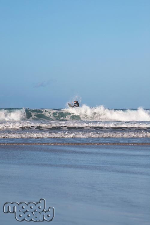 Man surfing waves