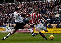 Photo. Glyn Thomas. <br /> <br /> Derby County v Sunderland.<br /> <br /> Coca Cola Championship. 16/01/2005.<br /> <br /> Sunderland's George McCartney (R) crosses the ball under pressure from Morten Bisgaard.