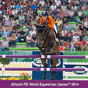 Maikel van der Vleuten - VDL Groep Verdi TN N.O.P.<br /> Alltech FEI World Equestrian Games™ 2014 - Normandy, France.<br /> © DigiShots