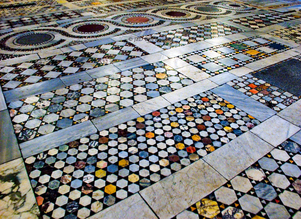 San Clemente, marble mosaic floor by the four brothers, known as the Cosmati from their father Cosmatus, between 1190 and 1235.  The floor is seen from a low angle to show extent and complexity of the geometric pattern.  Hexagons, triangles, circles, rectangles, squares, are set in a systematic close fitting design which I thought quite beautiful.