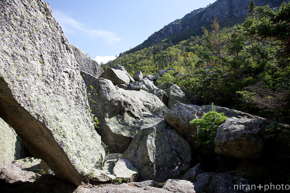A perfect example of what folks in Maine consider to be a trail: boulders with markers indicating the way up.
