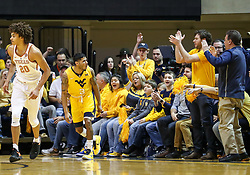 Jan 20, 2018; Morgantown, WV, USA; West Virginia Mountaineers guard James Bolden (3) celebrates with fans after a three pointer during the first half against the Texas Longhorns at WVU Coliseum. Mandatory Credit: Ben Queen-USA TODAY Sports