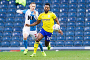 Birmingham City midfielder Jacques Maghoma tackled by the opponent during the EFL Sky Bet Championship match between Blackburn Rovers and Birmingham City at Ewood Park, Blackburn, England on 26 December 2019.