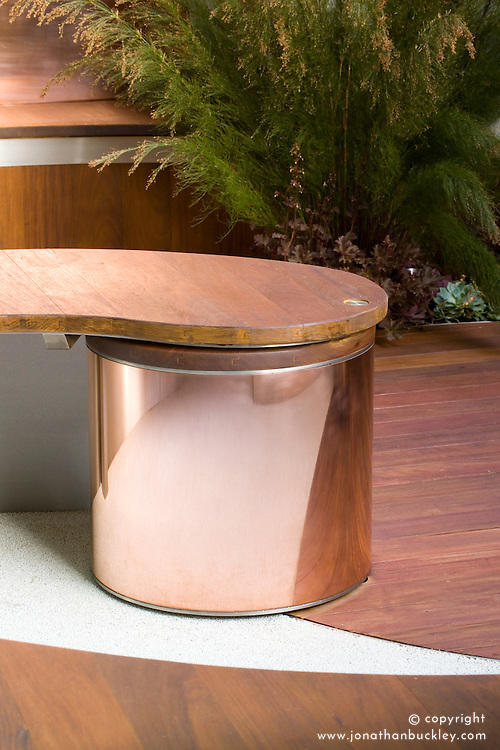 Wood and metal curved seat. Urban Space/Modern Eden Garden. Design: Kate Gould - Chelsea 2005