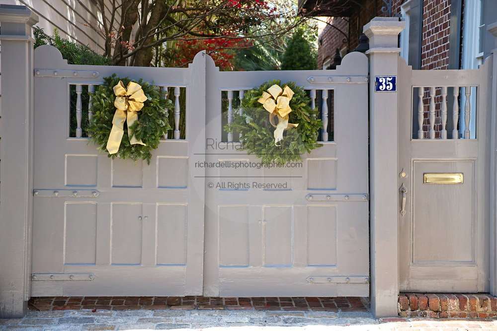 A historic home decorated with a Christmas wreath on Church Street in Charleston, SC.