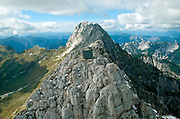 Sleeping In This Mountain Hut Is Totally Free - If You're Willing To Climb 8,300ft To Get There<br /> <br /> This mountain-top hut with a sweeping panoramic view of the Julian Alps in Italy is free to stay for anyone who knocks on its door. The catch? You'll have to hike 8,300ft up Foronon del Buinz Mountain to get to it.<br /> <br /> Commissioned by the family of the late mountain climber Luca Vuerich, who died in an avalanche in 2010, this unusual prefab wood cabin by architect Giovanni Pesamosca is located on the Ceria-Merlone trail and has been offering a safe refuge for hiking nature lovers since it opened in September 2012. The clever chapel-like design prevents snow from piling up on it, and its south-facing opening lets the sun melt any snow that builds up during winter.<br /> <br /> Due to the high altitude, the building materials for the hut were flown in by helicopter over 18 trips. A team of 12 professional workers, mountain rescue volunteers and Luca's friends then put the 16-sqm structure together in a single day.<br /> <br /> For the less adventurous, there's a vast network of similar huts scattered throughout the Alps at much lower altitudes, though you may have to pay to stay. Some even come with staff on duty in the summer who can cook and clean the place for hikers.<br /> ©giovanni pesamosca/Exclusivepix