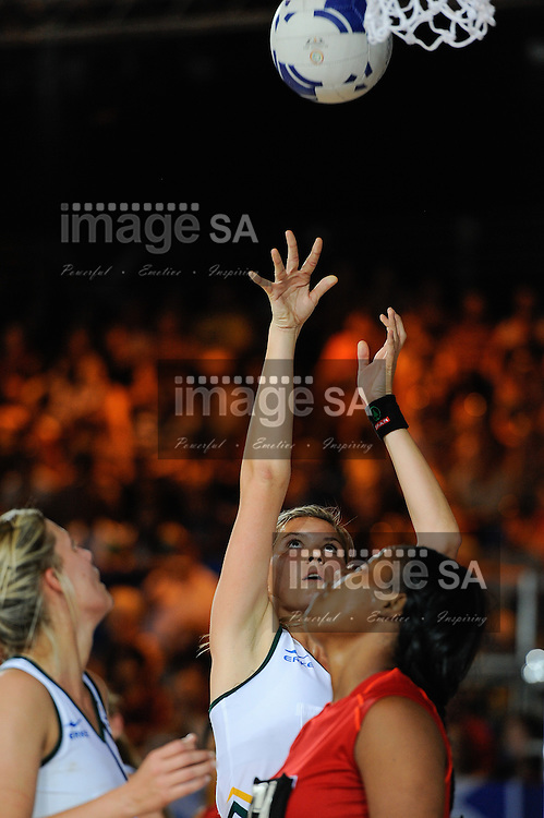 GLASGOW, SCOTLAND - JULY 25: Lenise Potgieter of South Africa shoots for goal during the netball match between South Africa and Trinidad and Tobago on day 2 of the 20th Commonwealth Games at Scottish Exhibition Centre on July 25, 2014 in Glasgow, Scotland. (Photo by Roger Sedres/ImageSA)