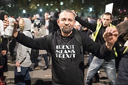 "© Licensed to London News Pictures . 05/11/2016 . London , UK . A man wearing a "" Brexit means Brexit "" t-shirt outside Downing Street . Supporters of Anonymous , many wearing Guy Fawkes masks , attend the Million Mask March bonfire night demonstration , in central London . Photo credit : Joel Goodman/LNP"