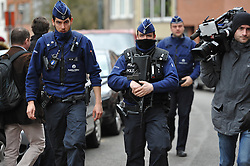 © Licensed to London News Pictures. 23/03/2016: Belgian police raid a property on Rue du Busselenberg - Busselenbergstraat following a  tip off from a taxi driver. The Belgian capital was hit by multiple bomb explosions in a terrorist attack on transport links in the city. Picture credit: Guilhem Baker/LNP