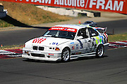 A BMW M3 negotiates turn 3 at the Infinion Raceway (formerly Sears Point) in Sonoma County, California, during qualifiers for an SCCA Regional/National Race.