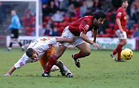 Photo: Dave Linney.<br />Walsall v Blackpool. Coca Cola League 1. 31/12/2005.<br />Jorge Leitao(Walsall) leaves  Scott Vernon(Blackpool) for dead.