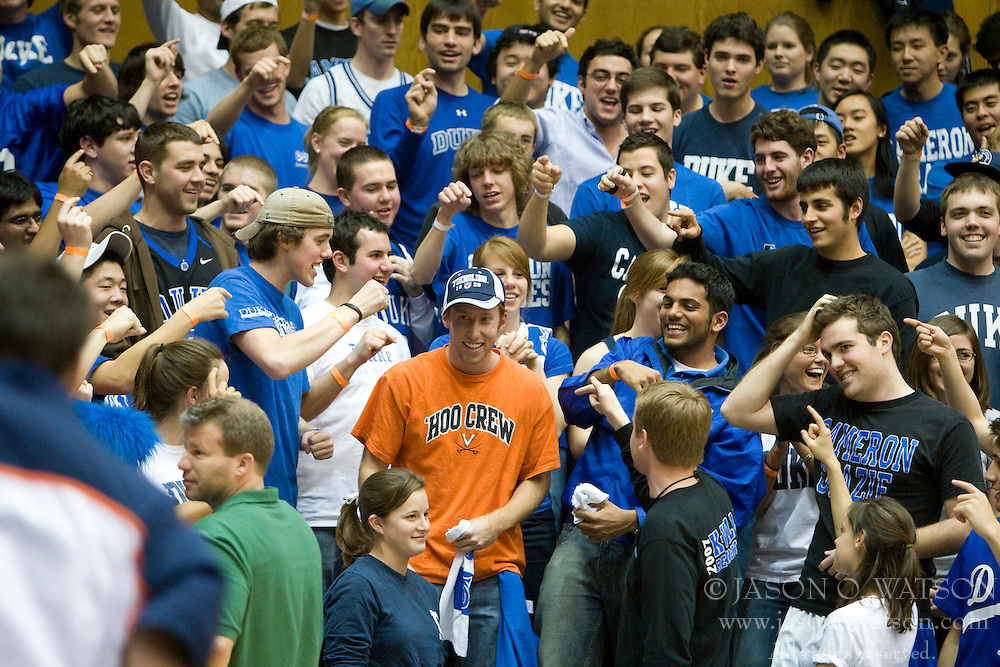 Cameron Crazies heckle a lone University of Virginia fan in the Duke student section.  The Duke Blue Devils defeated the Virginia Cavaliers 87-65 in men's basketball at Cameron Indoor Stadium on the campus of Duke University in Durham, NC on January 13, 2008.