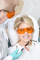 Dentist inspecting patient's teeth