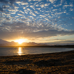 Sun set over otter cove on Unimak Island, Aleutians, Alaska