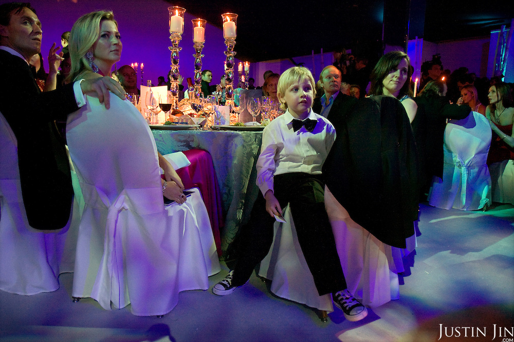 A boy and his parents attend a gala in Moscow.