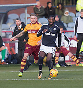 24th February 2018, Dens Park, Dundee, Scotland; Scottish Premier League football, Dundee versus Motherwell; Roarie Deacon of Dundee races away from Richard Tait of Motherwell