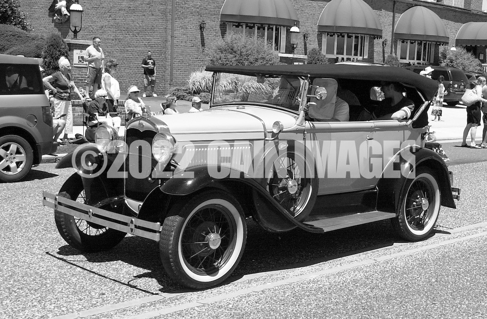An antique car is driven during the Independence Parade Saturday July 2, 2016 on Beach Avenue in Cape May, New Jersey. Photo by William Thomas Cain/Cain Images