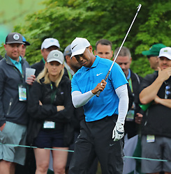 April 7, 2018 - Augusta, GA, USA - Tiger Woods is unhappy with his fairway shot on the 8th hole during the third round of the Masters Tournament on Saturday, April 7, 2018, at Augusta National Golf Club in Augusta, Ga. (Credit Image: © Curtis Compton/TNS via ZUMA Wire)