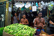Salvador, Brazil, October 2004.  The market of Salvador offers fresh fruit and vegetables as well as pottery and bikini's. The streets of Salvadors historical center are lined with colorful buildings from colonial times.  Photo by Frits Meyst/Adventure4ever.com