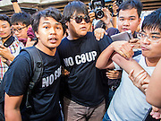 "14 FEBRUARY 2015 - BANGKOK, THAILAND: Anti-coup protestors scuffle with supporters of the military government during an anti-coup protest in Bangkok. Dozens of people gathered in front of the Bangkok Art and Culture Centre in Bangkok Saturday to hand out red roses and copies of George Orwell's ""1984."" Protestors said they didn't support either Red Shirts or Yellow Shirts but wanted a return of democracy in Thailand. The protest was the largest protest since June 2014, against the military government of General Prayuth Chan-Ocha, who staged the coup against the elected government. Police made several arrests Saturday afternoon but the protest was not violent.    PHOTO BY JACK KURTZ"