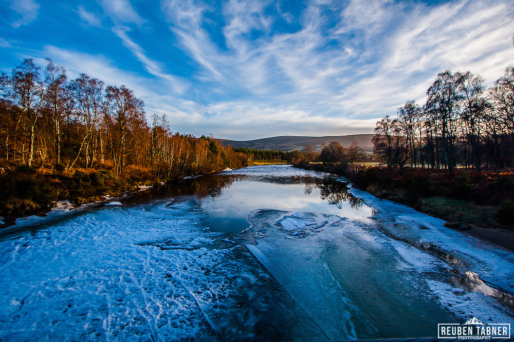 Looking down the frozen River Dee from the Cambus o' May Bridge, near Ballater, Royal Deeside, Scotland.