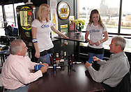 The Bud Light girls brought 'free stuff' to give away as some Dayton Gems players stopped by Brixx Ice Company during lunch to visit with fans (and potential fans,) across from Fifth Third Field, Tuesday, January 19, 2010.