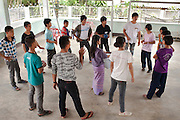 Ethnic Shan youths participate in a game to recap lessons learned at a two-day training on HIV/AIDS prevention run by Shan Youth Power (SYP) at Ban Wiang Wai, Chiang Mai, Thailand on July 16, 2011.