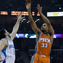 08 April 2009: Phoenix Suns forward Grant Hill (33) shoots over New Orleans Hornets forward Peja Stojakovic (16) during a NBA game between the New Orleans Hornets and the Phoenix Suns at the New Orleans Arena in New Orleans, Louisiana.