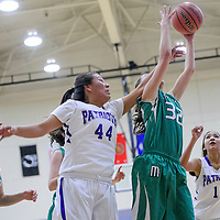 010215       Cable Hoover<br /> <br /> Moriarty Pinto Alyssa Adams (32) grabs a rebound away from Miiyamura Patriots Alaiah Nelson (44) and Sarah Gilmore (10) Friday at Miyamura High School.