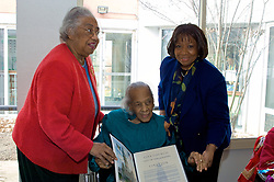 Wesley Enhanced Living at Stapeley, Germantown, Philadelphia, PA USA - March 10 2012; ..A Citation from the City of Philadelphia honoring and congratulating Miss Violet Addison with her 104th Birthday. The document is signed by 8th district city council woman Cindy Bass and City Counil President Darrell Clarke and is presented by friend and former superintendent Dr. Constance Clayton an a representive from the offfice of Cindy Bass...Friends and former plus current members of the Philadelphia Boys Choir & Chorale came out to celebrate the 104 birthday of Miss Violet Addison. Miss Violet Addison, born in 1908 is a highly-talented African American pianist. She traveled traveled around the world in the 30.s and 60.s for performances and personal enrichment...( Nikon D2X | ISO 800 | f5.6 | 1/125 | 27mm )
