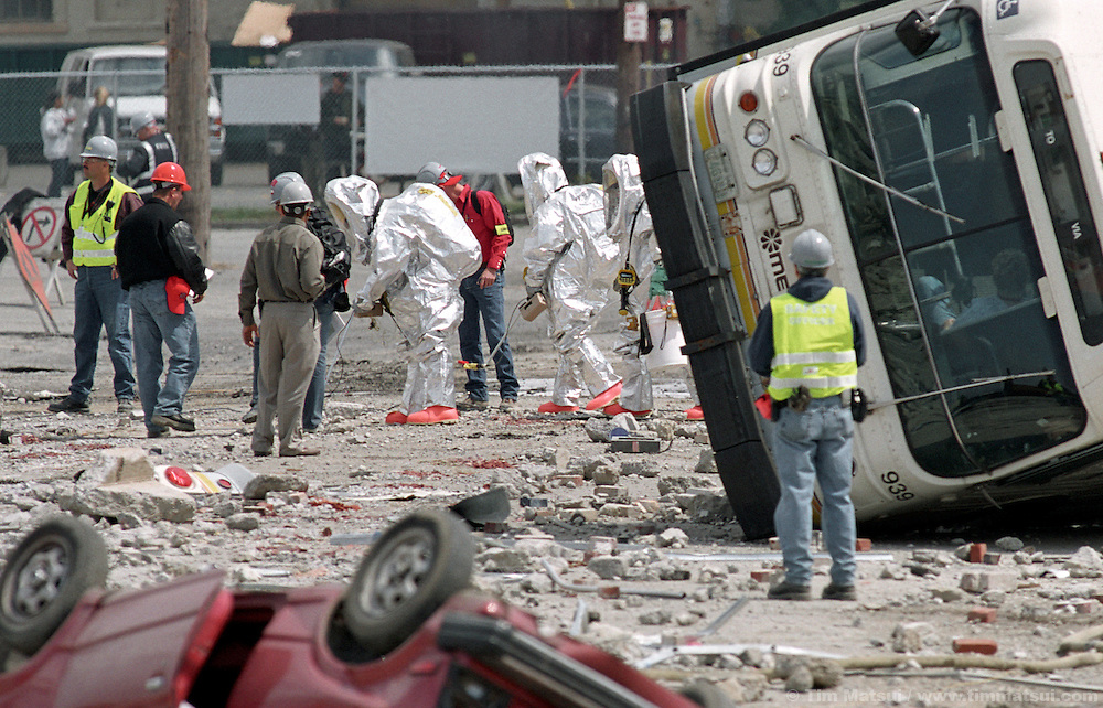 Seattle Fire Department personnel respond to a mock terrorist attack south of downtown on Monday, May 12, 2003 in Seattle, Washington. Controllers set off an explosion shortly after noon which simulated the detonation of a radioactive dispersal device or 'dirty bomb.'