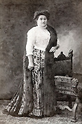 vintage full length portrait of woman in studio setting
