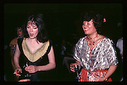 Katie Fraser and Rosmagh Catherwood at Piers Gaveston Ball. Oxford Town Hall. 1981 approx© Copyright Photograph by Dafydd Jones 66 Stockwell Park Rd. London SW9 0DA Tel 020 7733 0108 www.dafjones.com