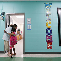 Lawhon Elementary School second grade teacher Caroline Turney welcomes Shera Traylor into her classroom as Tupelo Public School District gets the new school year underway on Thursday.