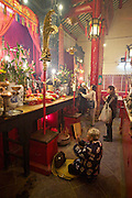 Central. Man Mo Temple. People offering incense.